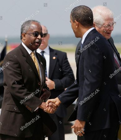 Barack Obama, Bill Bell President Barack Obama is greeted by Durham, N.C., Mayor Bill Bell as he arrives at Raleigh-Durham International Airport, in Morrisville, N.C
