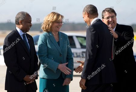 Barack Obama, Pat McCrory, Bill Bell, Nancy McFarlane President Barack Obama is greeted by, from left, Durham, N.C., Mayor Bill Bell, Raleigh, N.C., Mayor Nancy McFarlane, and North Carolina Gov. Pat McCrory, as he arrives on Air Force One at Raleigh-Durham International Airport, in Morrisville, N.C., en route to North Carolina State University where he will speak about the economy, jobs and