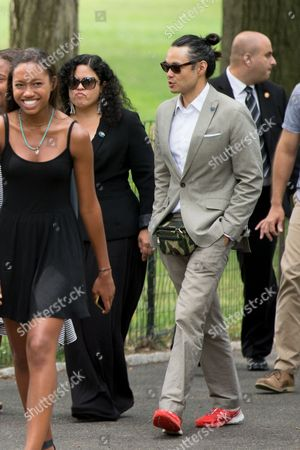 Maya Soetoro-Ng, Konrad Ngwalk Maya Soetoro-Ng, the sister of President Barack Obama, center left, and her husband Konrad Ngwalk, center right, accompany the president through Central Park, in New York. Obama is spending a mainly personal weekend with his daughters in New York City