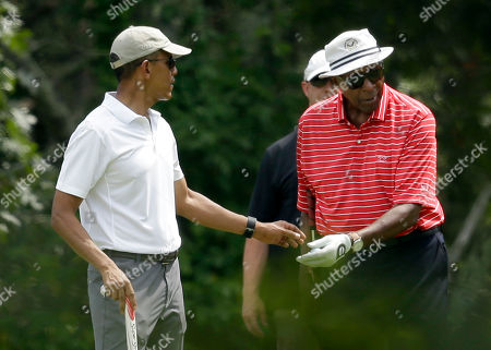 Barack Obama, Vernon Jordan President Barack Obama, left, hands a ball to Vernon Jordan, right, while golfing, at Farm Neck Golf Club, in Oak Bluffs, Mass., on the island of Martha's Vineyard