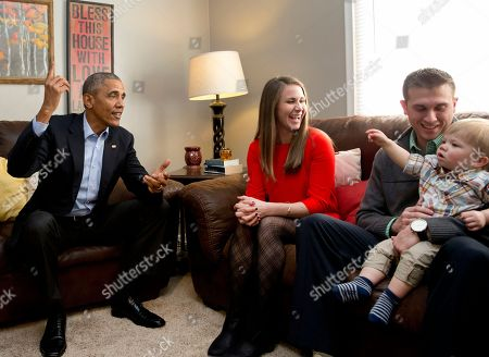 Barack Obama, Lisa Martin, Jeff Martin, Cooper Martin President Barack Obama visits with Lisa Martin, who wrote the president, her husband Jeff Martin and their son Cooper in their living room, in Omaha, Neb., . After giving his State of the Union address, he is in Omaha, Neb., to tout progress and goals in his final year in office
