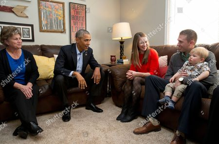 Barack Obama, Lisa Martin, Jeff Martin, Cooper Martin, Rebecca Hutchinson President Barack Obama visits with, from left, Rebecca Hutchinson, Lisa Martin, who wrote the president, her husband Jeff Martin, and their son Cooper in their living room, in Omaha, Neb., . After giving his State of the Union address, he is in Omaha, Neb., to tout progress and goals in his final year in office