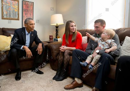 Stock Picture of Barack Obama, Lisa Martin, Jeff Martin, Cooper Martin President Barack Obama visits with Lisa Martin, who wrote the president, her husband Jeff Martin and their son Cooper in their living room, in Omaha, Neb., . After giving his State of the Union address, he is in Omaha, Neb., to tout progress and goals in his final year in office