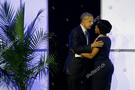 Stock Picture of Barack Obama, Roslyn Brock President Barack Obama, left, greets the NAACP's Roslyn Brock during the NAACP's 106th Annual National Convention, in Philadelphia