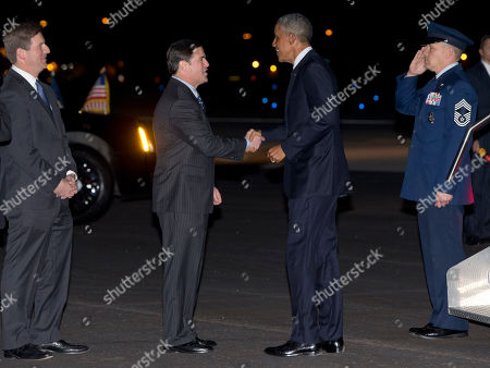 Barack Obama, Doug Ducey, Greg Stanton President Barack Obama is greeted by Republican Arizona Gov. Doug Ducey, second from left, as Phoenix Mayor Greg Stanton stands left, as he arrives on Air Force One at Phoenix Sky Harbor International Airport, in Phoenix. The president will speak at Central High School in Phoenix on Thursday, Jan. 8, 2015, about the recovering housing sector