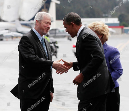 Barack Obama, Christine Gregoire, Michael McGinn President Barack Obama is greeted by Seattle Mayor Michael McGinn, left, upon his arrival at King County International Airport/Boeing Field, Sunday, Sept., 25, 2011, in Seattle. Partially visible at right is Washington Gov. Christine Gregoire
