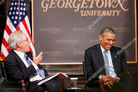 """Stock Picture of Barack Obama, E. J. Dionne President Barack Obama smiles as Washington Post Columnist E. J. Dionne speaks at the Catholic-Evangelical Leadership Summit on Overcoming Poverty at Gaston Hall at Georgetown University in Washington, . The president said that """"it's a mistake"""" to think efforts to stamp out poverty have failed and the government is powerless to address it"""