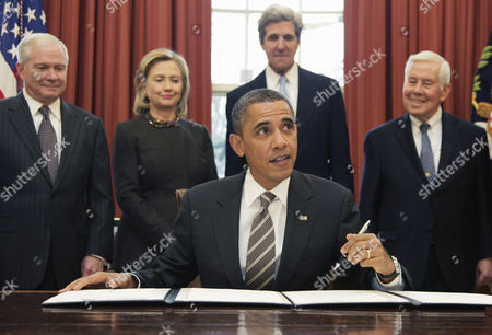 Stock Image of Barack Obama, Hillary Rodham Clinton, John Kerry, Richard Lugar, Robert Gates President Barack Obama looks up during the signing of the New START Treaty, in the Oval Office of the White House in Washington, . Standing, from left are, Defense Secretary Robert Gates, Secretary of State Hillary Rodham Clinton, Senate Foreign Relations Committee Chairman Sen. John Kerry, D-Mass., and the committee's ranking Republican Sen. Richard Lugar, R-Ind