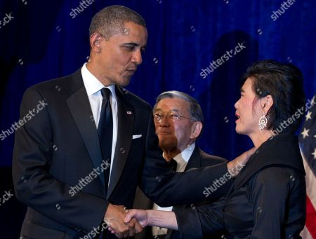 Barack Obama, Judy Chu, Norman Mineta President Barack Obama shakes hands with Rep. Judy Chu, D-Calif., as former Transportation Secretary Norman Mineta watches as he arrives to deliver the keynote address at the Asian Pacific American Institute for Congressional Studies dinner, in Washington