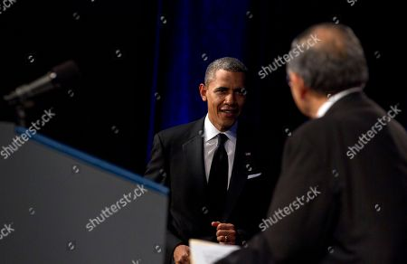 Barack Obama, Norman Mineta President Barack Obama looks to former Transportation Secretary Norman Mineta as he arrives to deliver the keynote address at the Asian Pacific American Institute for Congressional Studies dinner, in Washington