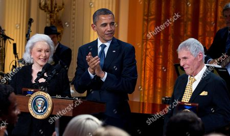 """Stock Picture of Barack Obama, Eunice David, Burt Bacharach President Barack Obama applauds after presenting the 2012 Library of Congress Gershwin Prize for Popular Song to songwriters Burt Bacharach, right, and Hal David, accepted by his wife Eunice at left, during the """"In Performance at the White House"""" in the East Room of the White House, in Washington"""