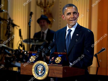 "Barack Obama President Barack Obama pauses as he speaks during the ""In Performance at the White House"" in the East Room of the White House, in Washington, honoring songwriters Burt Bacharach and Hal David, recipients of the 2012 Library of Congress Gershwin Prize for Popular Song"