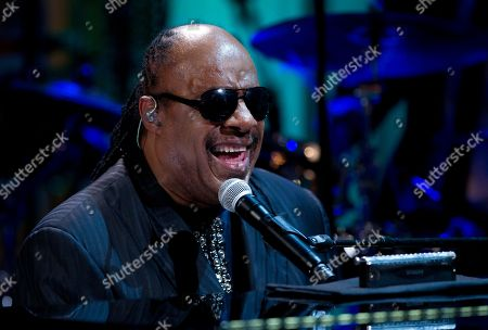 "Stevie Wonder Stevie Wonder smiles performs during the ""In Performance at the White House"" in the East Room of the White House, in Washington, honoring songwriters Burt Bacharach and Hal David, recipients of the 2012 Library of Congress Gershwin Prize for Popular Song"