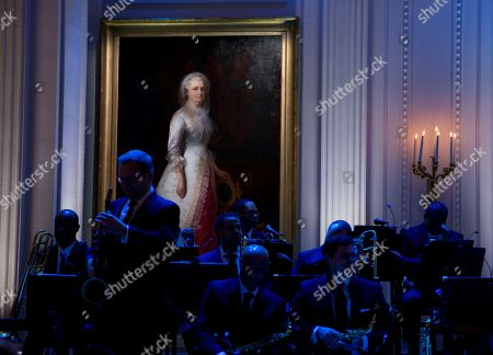 """Members of the Christian McBride Big Band prepare to perform for President Barack Obama and first lady Michelle Obama under a portrait of Martha Washington during the """"In Performance at the White House"""" series in the East Room of the White House, in Washington,. The event celebrates the iconic singer, songwriter, composer and musician Ray Charles"""