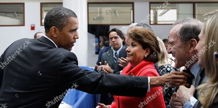Barack Obama, Janet Murguia, Mort Zuckerman President Barack Obama adjusts the collar of Mort Zuckerman, Chief Executive Officer of U.S. News and World Report, right, as Janet Murguia, President and CEO, National Council of La Raza, looks, after Obama spoke about immigration reform, at American University in Washington
