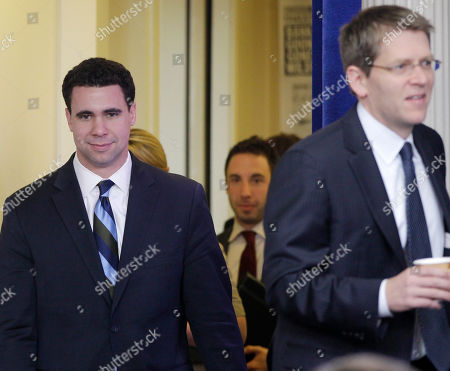 Jay Carney, Bill Burton Deputy White House Press Secretary Bill Burton, left, walks behind White House Press Secretary Jay Carney as they arrive to brief reporters at the White House in Washington