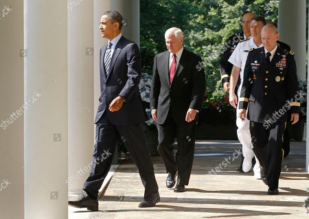 Barack Obama, Robert Gates, Ray Odierno, Martin Dempsey, James Winnefeld President Barack Obama, left, and Defense Secretary Robert Gates, center, walk to the Rose Garden at the White House in Washington with President Obama's nominee for the next Chairman of the Joint Chiefs of Staff Army Gen. Martin Dempsey, front to back right, nominee Adm. James Winnefeld to be vice chairman of the Joint Chiefs, and Gen. Ray Odierno to be Army Chief of Staff