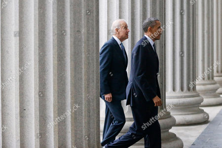 Barack Obama, Joe Biden President Barack Obama, accompanied by Vice President Joe Biden, walks from the White House to the Treasury Department to attend an event for outgoing Treasury Secretary Timothy Geithner