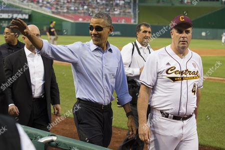Barack Obama, Dan Kildee President Barack Obama, left, walks with Rep. Dan Kildee, D-Mich., as he makes a visit to the Congressional baseball game at Nationals Park,, in Washington