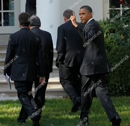 Barack Obama, Samuel Skinner, Norman Mineta, Timonthy Geithner President Barack Obama points upwards as he walks back to the Oval Office after speaking to reporters in the Rose Garden to highlight a new report on the impact of his $50 billion infrastructure-investment proposal, at the White House in Washington. Walking ahead of Obama are from left to right, Secretary of Treasury Timonthy Geithner, former Secretaries of Transportation Norman Mineta and Samuel Skinner