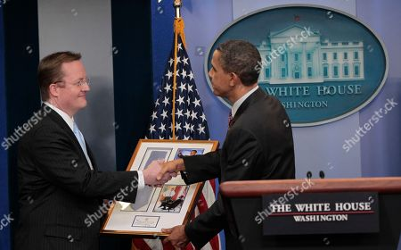 Robert Gibbs, Barack Obama President Barack Obama, right, presents a framed gift to White House Press Secretary Robert Gibbs, left, at daily news briefing at the White House in Washington, Friday, Feb., 11, 2011. Gibbs steps down from the post today, after two years as President Obama's top spokesman. Jay Carney, the current communications director for Vice President Joe Biden, will succeed him at the podium