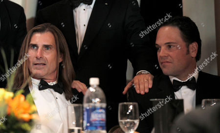 Fabio Lanzoni, Mike Piazza Model and actor Fabio Lanzoni, left, and former major league baseball player Mike Piazza, right, wait for the arrival of President Barack Obama to delivers remarks at the National Italian American Foundation (NIAF) Gala in Washington, Saturday, Oct., 29, 2011