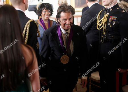 Al Pacino, Rita Dove 2011 National Medal of the Arts recipients, actor, Al Pacino, center, and poet and author Rita Dove, rear, leave the East Room of the White House in Washington, following the awards ceremony