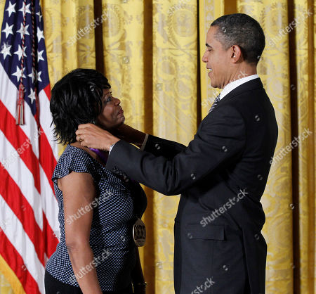 Brack Obama, Rita Dove President Barack Obama presents a 2011 National Medal of the Arts to poet and author Rita Dove, Monday, Feb., 13, 2012, during a ceremony in the East Room of the White House in Washington