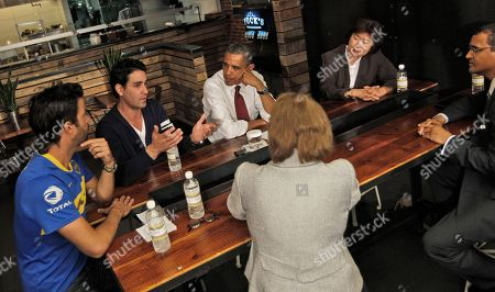 Barack Obama, Karen Mills, David Mazza, Casey Patten, Kathy Rachels, Brian J. Smith President Barack Obama, and SBA Administrator Karen Mills, sitting across from Obama, participate in a roundtable discussion with local small business owners at Taylor Gourmet in the U Street neighborhood in Washington, . From left are, Taylor Gourmet Co-owners David Mazza, and Casey Patten, the president, Kathy Rachels, President of Yes Organic Market and Brian J. Smith, of Francis Lee Contracting