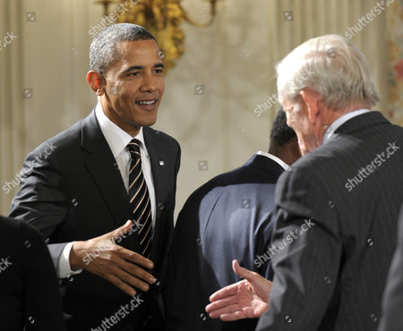 Barack Obama, William Donaldson President Barack Obama shakes hands with former Security and Exchange Commission (SEC) Chairman William Donaldson, before the start of a meeting of the President's Economic Recovery Advisory Board (PERAB), in the State Dining Room of the White House in Washington
