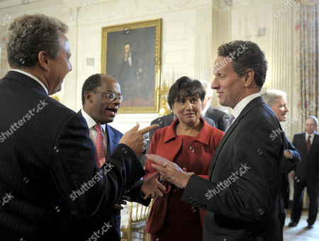 Robert Wolf, Roger Ferguson, Penny Pritzker, Timothy Geithner Treasury Secretary Timothy Geithner, right, talks with, from left, UBS Group Americas President and CEO Robert Wolf, TIAA-CREF President and Chief Executive Officer Roger W. Ferguson, Jr., and Pritzker Realty Group Chair and founder of Penny Pritzker, before the start of a meeting with President's Economic Recovery Advisory Board (PERAB), in the State Dining Room of the White House in Washington
