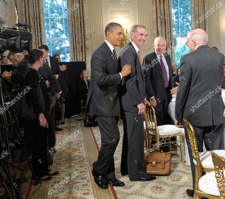 Stock Photo of Barack Obama, William Donaldson, David Swensen President Barack Obama, left, walks past Yale University's David Swensen, second from left, and former SEC Chairman William Donaldson, second from right, before the start of a meeting of the President's Economic Recovery Advisory Board (PERAB), in the State Dining Room of the White House in Washington