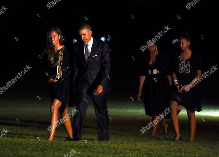 Barack Obama, Michelle Obama, Malia Obama, Sasha Obama President Barack Obama, second from left, walks with daughter Malia, left, as first lady Michelle Obama, second from right, and daughter Sasha, right, follow behind, walking from Marine One on the South Lawn of the White House in Washington, . The first family was returning after attending the wedding of Sam Kass, their longtime family chef. The bride is MSNBC host Alex Wagner. The wedding is at a farm-to-table restaurant in Westchester County, north of New York City