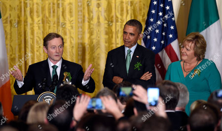 Barack Obama, Edna Kenny, Fionnuala Kenny Irish Prime Minister Enda Kenny, left, speaks as President Barack Obama, center, and Kenny's wife Fionnuala Kenny, right, listen during a St. Patrick's Day reception in the East Room of the White House in Washington, . Obama is celebrating his seventh St. Patrick's Day in the White House