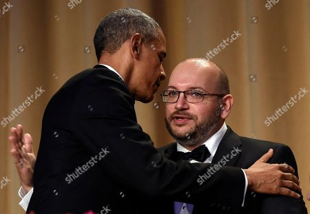Barack Obama, Jason Rezaian President Barack Obama, left, hugs Jason Rezaian, right, the Washington Post reporter freed after being detained for more than 18 months in Iran, during the annual White House Correspondents' Association dinner at the Washington Hilton in Washington