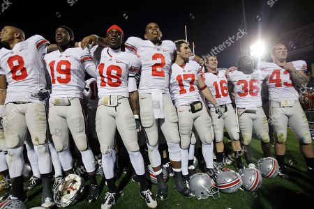 Terrelle Pryor, Travis Howard, Brian Rolle, Nathan Williams, DeVier Posey, Orhian Johnson, Grant Schwartz, Zach Domicone In this, Ohio State teammates from left DeVier Posey (8), Orhian Johnson (19), Travis Howard (18), Terrelle Pryor (2), Grant Schwartz (17), Zach Domicone (16) Brian Rolle (36) and Nathan Williams (43) celebrate with the Ohio State student section and teammates after defeating Penn State 24-7 in an NCAA college football game in State College, Pa