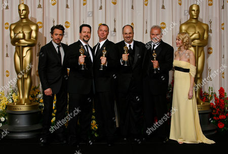 Robert Downey Jr., Naomi Watts, John Knoll, Hal Hickel, Charles Gibson, Allen Hall Actors Robert Downey Jr., right, and Naomi Watts pose with John Knoll, Hal Hickel, Charles Gibson and Allen Hall after presenting them the Oscar for visual effects during the 79th Academy Awards, in Los Angeles