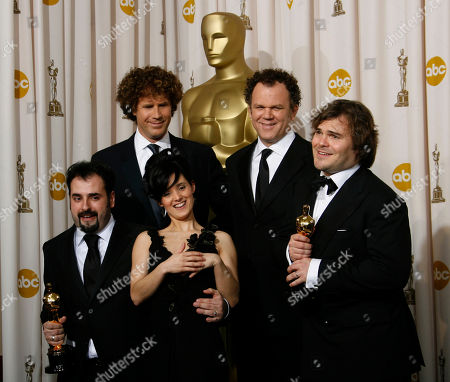 "David Marti, Montse Ribe, Will Ferrell, John C. Reilly, Jack Black David Marti and Montse Ribe pose with the Oscar for achievement in makeup for their work on ""Pan's Labyrinth"" during the 79th Academy Awards, in Los Angeles. Presenters Will Ferrell, left, John C. Reilly and Jack Black look on"