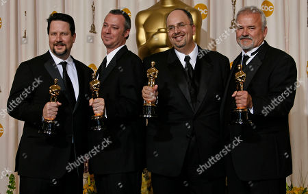 John Knoll, Hal Hickel, Charles Gibson, Allen Hall From left: John Knoll, Hal Hickel, Charles Gibson and Allen Hall after presenting them the Oscar for visual effects during the 79th Academy Awards, in Los Angeles