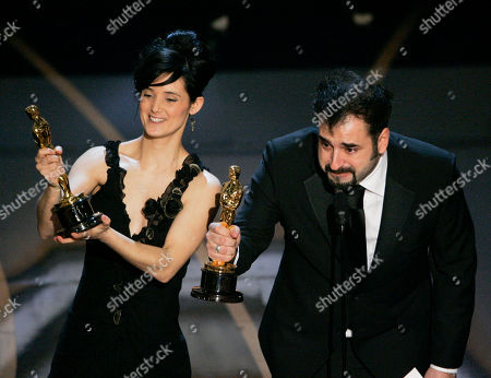 "Montse Ribe, David Marti SCIENCES FOR USE UPON CONCLUSION OF THE ACADEMY AWARDS TELECAST** Montse Ribe and David Marti accept the Oscar for achievement in makeup for their work on ""Pan's Labyrinth"" during the 79th Academy Awards, in Los Angeles"
