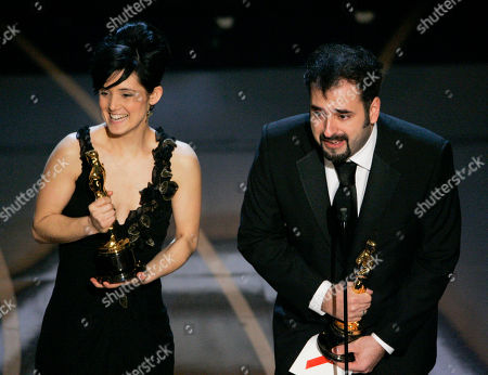 """Montse Ribe, David Marti SCIENCES FOR USE UPON CONCLUSION OF THE ACADEMY AWARDS TELECAST** Montse Ribe and David Marti accept the Oscar for achievement in makeup for their work on """"Pan's Labyrinth"""" during the 79th Academy Awards, in Los Angeles"""