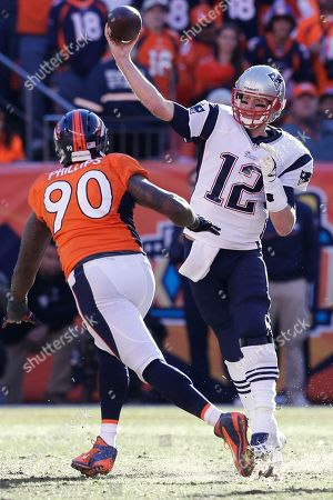 New England Patriots quarterback Tom Brady (12) throws a pass over Denver Broncos defensive end Shaun Phillips (90) during the second half of the AFC Championship NFL playoff football game in Denver