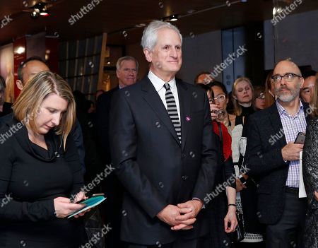 Edwin Schlossberg Edwin Schlossberg, center, listens as his wife, U.S. Ambassador to Japan Caroline Kennedy speaks during a ceremony commemorating the opening of a Japanese Kamakura sculpture exhibition at the Asia Society, in New York