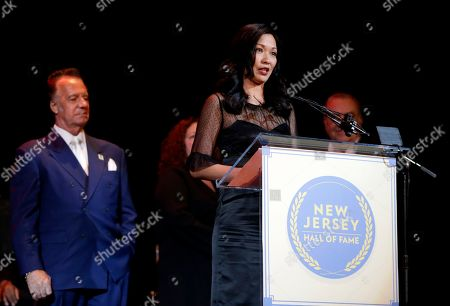 """Stock Photo of Deborah Lin, Tony Sirico Deborah Lin, widow of actor James Gandolfini, accepts his induction into the New Jersey Hall of Fame, in Asbury Park, N.J. Also seen is actor Tony Sirico, left, who played the role of Paulie """"Walnuts"""" Gualtieri along side Gandolfini in the cable series The Sopranos"""