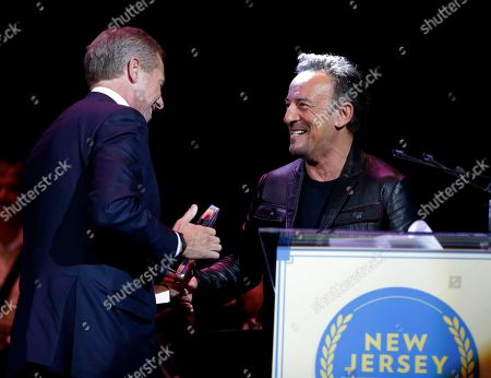 Bruce Springsteen, Brian Williams Musician Bruce Springsteen, right, greets television journalist Brian Williams on stage as Williams is inducted into the New Jersey Hall of Fame, in Asbury Park, N.J. Among the inductees were actor James Gandolfini, who played the lead role in the cable series The Sopranos