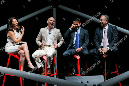 Stock Photo of Armando Christian Perez, Pitbull, Melissa Lee, Mark Hoffman, Cesar Conde Entertainer Armando Christian Perez, second left, known as Pitbull, laughs with moderator Melissa Lee, left, and fellow panelists Cesar Conde, chairman of NBCUniversal International Group, and NBCUniversal Telemundo Enterprises, Mark Hoffman, right, during a discussion on the changing worlds of media at the eMerge Americas technology event, in Miami Beach, Fla