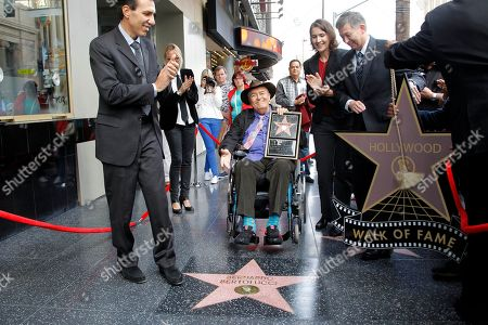 Guiseppe Perrone Bernardo Bertalucci Heather Cochran Leron Gubler Italian director Bernardo Bertolucci, center, holds a star plaque as he makes a rare visit to his star on the Hollywood Walk of Fame,, in Los Angeles. Italian Consul General Giuseppe Perrone, left, Hollywood Chamber of Commerce Chairman of the Board Heather Cochran, second right, and President and CEO Hollywood Chamber of Commerce Leron Gubler, right, celebrate with the director to mark the 2,513th star he received in the category of Motion Pictures. In 2008, the Hollywood Chamber of Commerce placed a star for the renowned director on the Walk of Fame and Bertolucci could not attend the occasion due to illness