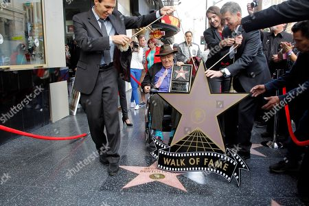 Giuseppe Perrone, Bernardo Bertalucci, Heather Cochran, Leron Gubler Italian director Bernardo Bertolucci, center, holds a star plaque as he makes a rare visit to his star on the Hollywood Walk of Fame,, in Los Angeles. Italian Consul General Giuseppe Perrone, left, Hollywood Chamber of Commerce Chairman of the Board Heather Cochran, second right, and President and CEO Hollywood Chamber of Commerce Leron Gubler, right, celebrate with the director to mark the 2,513th star he received in the category of Motion Pictures. In 2008, the Hollywood Chamber of Commerce placed a star for the renowned director on the Walk of Fame which Bertolucci could not attend due to illness