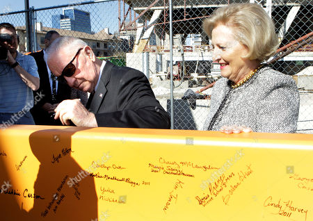 Ross Perot, Margot Perot Ross Perot, left, signs a beam during a ceremony at the construction site for Perot Museum of Nature and Science as his wife Margot, right, looks, in Dallas. The billionaire former presidential candidate Perot and his family attended a ceremony to celebrate the placement of the final beam in the construction of the museum by the downtown area
