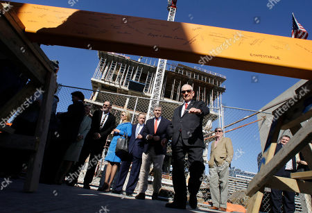 Ross Perot Ross Perot, center right, escorts the next signee to a beam, foreground, during a ceremony at the construction site of the Perot Museum of Nature and Science, seen in the background, in Dallas. The billionaire former presidential candidate Perot and his family attended a ceremony to celebrate the placement of the final beam in the construction of the museum near downtown Dallas